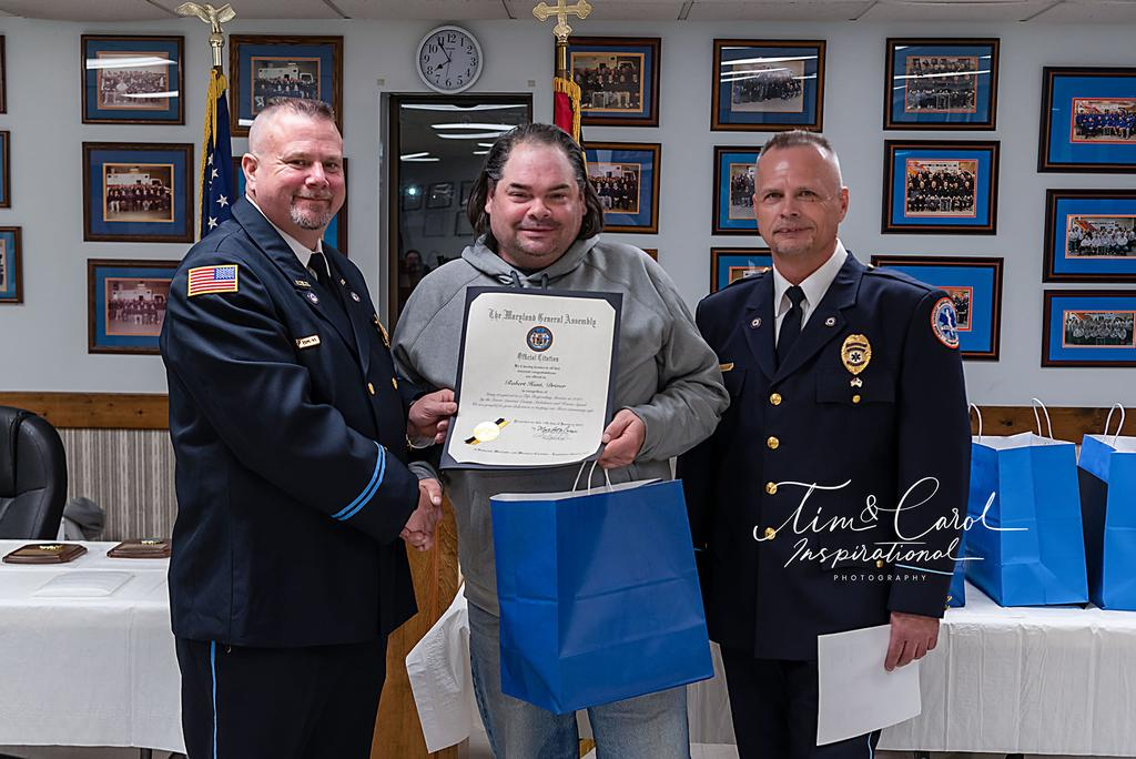 Driver Robert Hunt receiving his award for Top Ten calls and Governor's Citation.