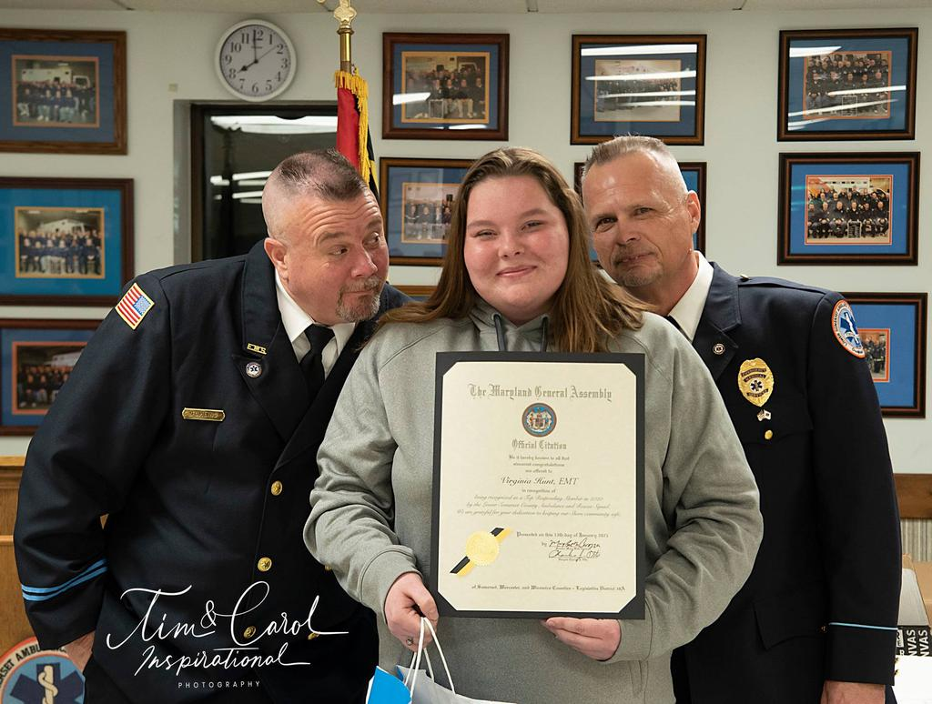 EMT Virginia Hunt receiving her Top Ten awards and Governor's Citation.